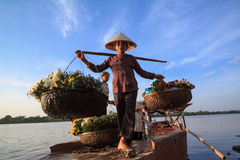 Unidentified farmers carry flowers to the market Stock Photo