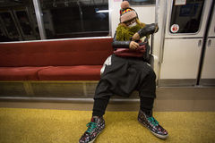 Unidentified Fashion Man sleeping in Tokyo metro Royalty Free Stock Photo