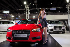 Unidentified female models with Audi A3 Limousine Stock Photo
