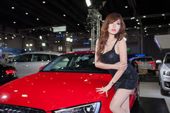 Unidentified female models with Audi A3 Limousine Royalty Free Stock Image