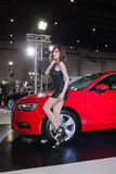 Unidentified female models with Audi A3 Limousine Stock Photos