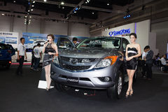 Unidentified female models with Mazda Royalty Free Stock Photos