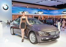 Unidentified female presenter with BMW car Stock Photography