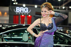 Unidentified female presenter with BRG Carlsson car Royalty Free Stock Images