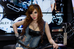 Unidentified female presenter of Harley Davidson in Motor Show. Bangkok, Thailand - March 28, 2014: Unidentified female presenter of Harley Davidson motorcycle Stock Photos