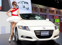 Unidentified female presenter at Honda booth Royalty Free Stock Images