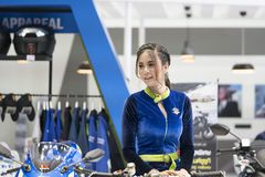 An unidentified female presenter models. Bangkok-Thailand-3 December 2017: An unidentified female presenter models at Suzuki motorbike booth at Motor Show royalty free stock image