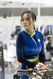 An unidentified female presenter models. Bangkok-Thailand-3 December 2017: An unidentified female presenter models at Suzuki motorbike booth at Motor Show stock image