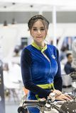 An unidentified female presenter models. Bangkok-Thailand-3 December 2017: An unidentified female presenter models at Suzuki motorbike booth at Motor Show royalty free stock images