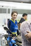 An unidentified female presenter models. Bangkok-Thailand-3 December 2017: An unidentified female presenter models at Suzuki motorbike booth at Motor Show royalty free stock photo