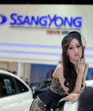 Unidentified female presenter at Ssongyong booth Royalty Free Stock Photos