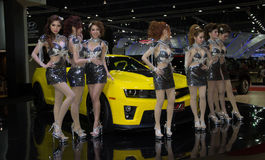 Unidentified female presenters of Chevrolet. Bangkok, Thailand - March 28, 2014: Unidentified female presenters of Chevrolet car in Bangkok Motor Show 2014 Royalty Free Stock Image