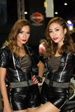 Unidentified female presenters of Harley Davidson in Motor Show. Bangkok, Thailand - March 29, 2013: Unidentified female presenters of Harley Davidson in Bangkok Stock Photos