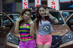Unidentified female presenters of Isuzu in Motor Show. Bangkok, Thailand - March 28, 2014: Unidentified female presenters of Isuzu car in Bangkok Motor Show 2014 Royalty Free Stock Photo