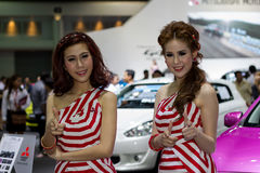 Unidentified female presenters of Mitsubishi car in Motor Show. Bangkok, Thailand - March 29, 2013: Unidentified female presenters of Mitsubishi car in Bangkok Stock Image