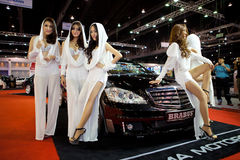 Unidentified females presenter at brabus booth Stock Photos