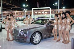 Unidentified females presenter at Jaguar booth Royalty Free Stock Photo