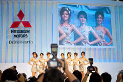 Unidentified females presenter at Mitsubishi booth Royalty Free Stock Images