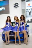 Unidentified females presenter at Suzuki booth Stock Images