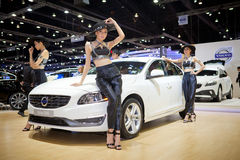 Unidentified females presenter with Volvo S60 car Stock Photos