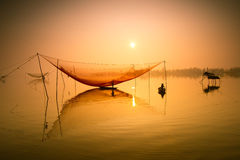 Free Unidentified Fisherman Checks His Nets In Early Morning On River In Hoian, Vietnam Stock Images - 57808984
