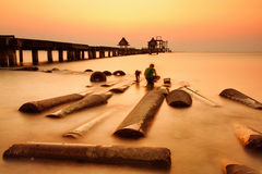 Unidentified Fisherman and dog fishing at the bridge in sunset.Thailand Stock Images