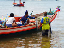 Unidentified fishermen are carry fish to keep the cart Stock Image