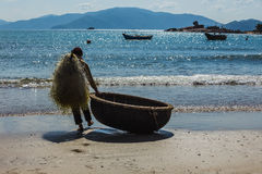 Unidentified fishermen is working on the beach in Nha Trang, Vie Royalty Free Stock Image