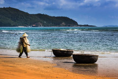 Unidentified fishermen is working on the beach in Nha Trang, Vie Royalty Free Stock Photography