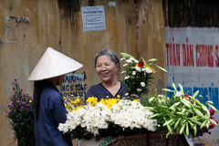 Unidentified flower vendor at the flower small market Royalty Free Stock Images