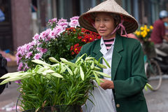 Unidentified flower vendor at the flower small market Royalty Free Stock Photos