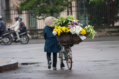 Unidentified flower vendor at the flower small market Royalty Free Stock Photography
