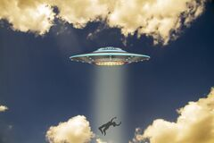 Free Unidentified Flying Object With The Ascension Of A Person Along A Ray Of Light Against The Sky. UFO Concept For Designers With A Royalty Free Stock Photos - 190223258