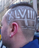 Unidentified football with Super Bowl XLVIII hair style in Manhattan Stock Photo