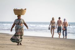 An unidentified fruit vendor on the beach in Goa, India Royalty Free Stock Image