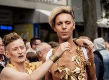 Unidentified gays during Gay pride parade. BERLIN, GERMANY - JUNE 21, 2014:Christopher Street Day.Crowd of people participate in the parade celebrates gays Stock Image