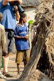 Unidentified Ghanaian boy in blue shirt looks around in the Gha stock photos