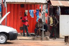 Unidentified Ghanaian group of people gather near the shack on. KUMASI, GHANA - Jan 16, 2017: Unidentified Ghanaian group of people gather near the shack on the stock photos