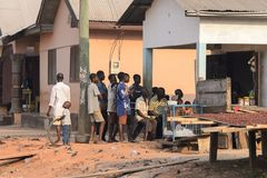 Unidentified Ghanaian people gather near the building in local. CENTRAL REGION, GHANA - Jan 17, 2017: Unidentified Ghanaian people gather near the building in stock image