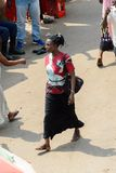 Unidentified Ghanaian woman with braids walks at the Kumasi mar. KUMASI, GHANA - JAN 15, 2017: Unidentified Ghanaian woman with braids walks at the Kumasi market royalty free stock photos