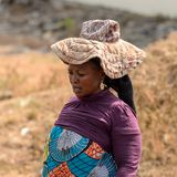 Unidentified Ghanaian woman in a hat with wide brim in local vi. CENTRAL REGION, GHANA - Jan 17, 2017: Unidentified Ghanaian woman in a hat with wide brim in royalty free stock image