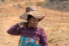 Unidentified Ghanaian woman in a hat with wide brim in local vi. CENTRAL REGION, GHANA - Jan 17, 2017: Unidentified Ghanaian woman in a hat with wide brim in royalty free stock photos