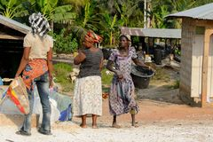 Unidentified Ghanaian women stand in local village. stock images