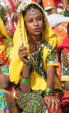 An unidentified girl  in colorful ethnic attire attends at the P Royalty Free Stock Image
