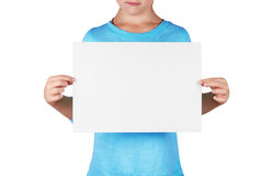 Unidentified girl holds a blank sheet of paper Royalty Free Stock Photo