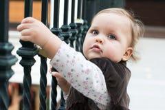 Unidentified girl on Love locks bridge in Paris. Royalty Free Stock Photos