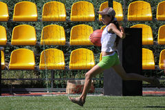 Unidentified girl runs with ball Royalty Free Stock Images