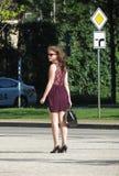Unidentified girl in stylish summer short dress. BRNO, CZECH REPUBLIC - CIRCA MAY 2017: unidentified girl in stylish summer short dress Royalty Free Stock Photos