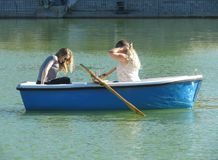 Unidentified girls on a boat Stock Image