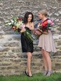 Unidentified girls with flower bouquets Royalty Free Stock Photography